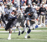 Purdue wide receiver Isaac Zico, left, runs the ball as Illinois' Jartavius Martin (21) and Kerby Joseph (26) attempt the tackle in the first half of an NCAA college football game, Saturday, Oct. 13, 2018, in Champaign, Ill. (AP Photo/Holly Hart)