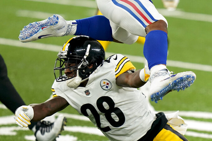 New York Giants running back Saquon Barkley leaps over Pittsburgh Steelers cornerback Mike Hilton (28) during the second quarter of an NFL football game Monday, Sept. 14, 2020, in East Rutherford, N.J. (AP Photo/Frank Franklin II)
