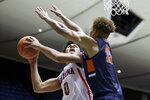 Arizona guard Josh Green, left, shoots as Pepperdine forward Kessler Edwards defends during the first half of an NCAA college basketball game at the Wooden Legacy tournament in Anaheim, Calif., Thursday, Nov. 28, 2019. (AP Photo/Alex Gallardo)