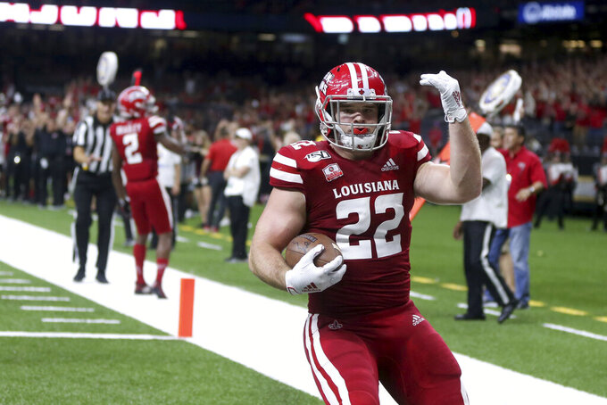 Louisiana-Lafayette tight end Nick Ralston (22) celebrates his touchdown in the second quarter of an NCAA football game against the Mississippi State in New Orleans, Saturday, Aug. 31, 2019. (AP Photo/Chuck Cook)