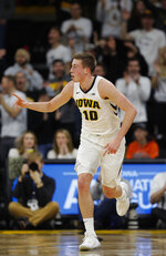 Iowa guard Joe Wieskamp celebrates a three-point basket during the first half of an NCAA college basketball game against Illinois, Sunday, Jan. 20, 2019, in Iowa City. (AP Photo/Matthew Putney)