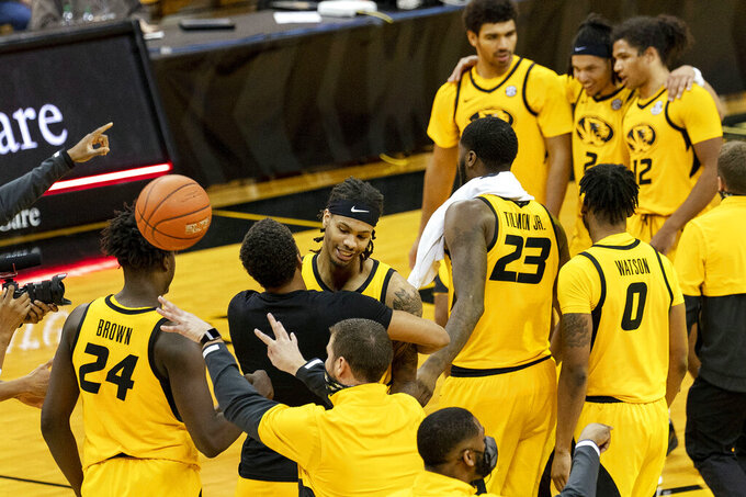 Missouri's Mitchell Smith, center, celebrates with teammates after they defeated Alabama 68-65 in an NCAA college basketball game Saturday, Feb. 6, 2021, in Columbia, Mo. (AP Photo/L.G. Patterson)