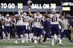 New England Patriots' Rob Gronkowski (87) celebrates with teammates after the NFL Super Bowl 53 football game against the Los Angeles Rams, Sunday, Feb. 3, 2019, in Atlanta. The Patriots won 13-3. (AP Photo/Carolyn Kaster)