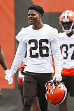 Cleveland Browns cornerback Greedy Williams watches from the sideline NFL football practice at the team's training facility, Wednesday, June 9, 2021, in Berea, Ohio. (AP Photo/Ron Schwane)