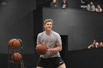 This Jan. 3, 2020, photo provided by Jessica Forbes shows Jake Murphy playing basketball at a PowerHouse Hoops facility in Phoenix. The coronavirus pandemic put sports on hold and the AAU circuit with it, leaving non-elite basketball recruits with no opportunity to make an in-person impression on college coaches. Murphy opted to take the most sensible road rather than try sorting through the uncertainty, committing to play at the Air Force Academy, where his brother was already a cadet. (Jessica Forbes via AP)