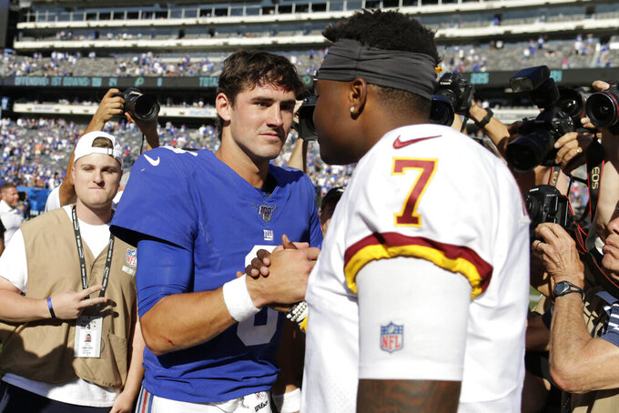 New York Giants quarterback Daniel Jones, left, greets Washington Redskins quarterback Dwayne Haskins after an NFL football game, Sunday, Sept. 29, 2019, in East Rutherford, N.J. The Giants defeated the Redskins 24-3. (AP Photo/Adam Hunger)