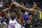 Baylor guard Mark Vital (11) blocks a shot by Kansas center Udoka Azubuike (35) during the first half of an NCAA college basketball game in Lawrence, Kan., Saturday, Jan. 11, 2020. (AP Photo/Orlin Wagner)