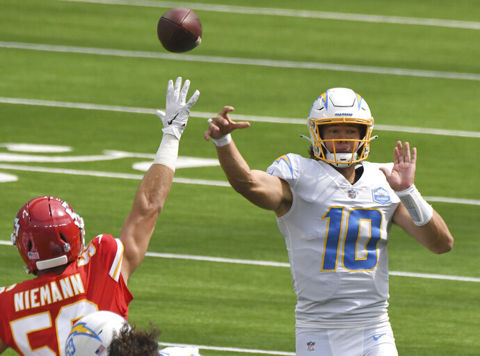 Los Angeles Chargers quarterback Justin Herbert (10) passes against the Kansas City Chiefs in the first half of an NFL football game in Inglewood, Calif., Sunday, Sept. 20, 2020. (Keith Birmingham/The Orange County Register via AP)
