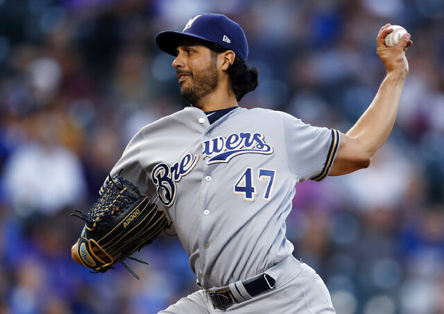 FILE - In this Sept. 28, 2019, file photo, Milwaukee Brewers starting pitcher Gio Gonzalez works against the Colorado Rockies in the first inning of a baseball game in Denver. The Chicago White Sox boosted their starting rotation, agreeing to a $5 million, one-year contract with two-time All-Star González that includes a club option for the 2021 season. The deal announced Friday, Dec. 20, 2019, calls for him to earn $4.5 million in salary next season. (AP Photo/David Zalubowski, File)