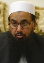 FILE - In this July 13, 2016 file photo, taken in Lahore, Pakistan, Hafiz Saeed, a declared a terrorist by the United Nations and the United States, is leading the campaign for candidates of the radical Allah-o-Akbar Tehreek party. Pakistan on Wednesday, July 17, 2019, arrested Saeed, a radical cleric and U.S.-wanted terror suspect implicated in the 2008 Mumbai attacks, officials said, just days ahead of Prime Minister Imran Khan's trip to Washington. (AP Photo/K.M. Chaudary, File)