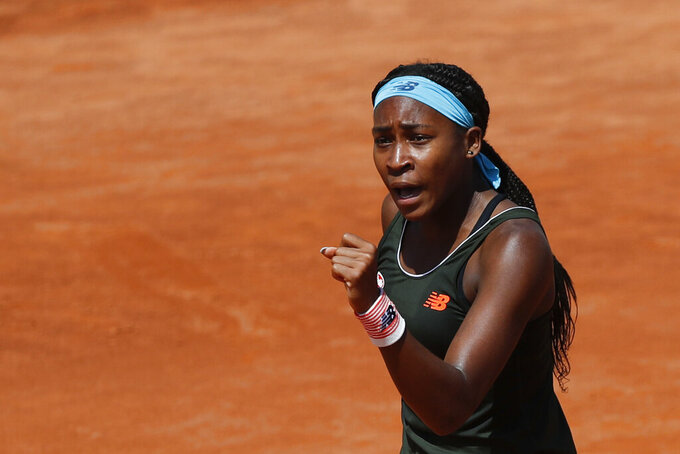 Cori Gauff of the United States reacts after missing a point against Aryna Sabalenka of Belarus during their 3rd round match at the Italian Open tennis tournament, in Rome, Thursday, May 13, 2021. Gauff won 7-5, 6-3. (AP Photo/Alessandra Tarantino)