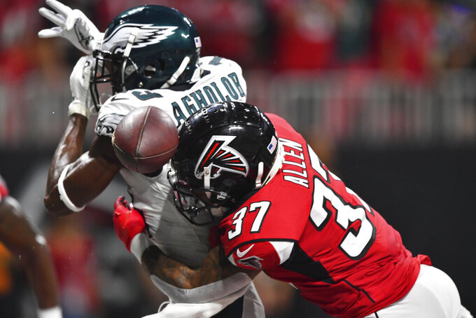 Philadelphia Eagles wide receiver Nelson Agholor (13) is hit by Atlanta Falcons free safety Ricardo Allen (37) during the first half of an NFL football game, Sunday, Sept. 15, 2019, in Atlanta. (AP Photo/John Amis)