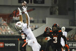 Stanford wide receiver Elijah Higgins (6) reaches up to catch a pass as Oregon State defensive back Jaydon Grant watches during the second half of an NCAA college football game in Corvallis, Ore., Saturday, Dec. 12, 2020. Stanford won 27-24. (AP Photo/Amanda Loman)