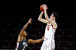 Southern California guard Drew Peterson (13) shoots over Washington State guard Myles Warren (2) during the second half of an NCAA college basketball game Saturday, Jan. 16, 2021, in Los Angeles. (AP Photo/Ringo H.W. Chiu)