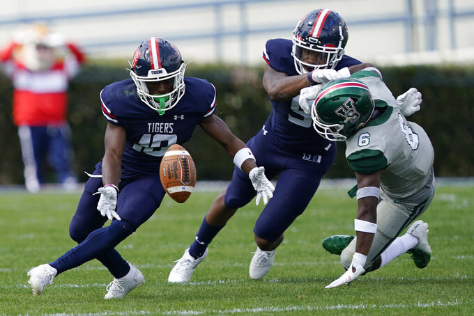 Jackson State wide receiver Warren Newman (10) attempts to catch a bobbled pass as Mississippi Valley State defender Keonte' Daniels (6) is blocked by a Jackson State teammate during the first half of an NCAA college football game, Sunday, March 14, 2021, in Jackson, Miss. (AP Photo/Rogelio V. Solis)