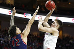 Gonzaga's Filip Petrusev (3) shoots over Saint Mary's Dan Fotu (42) in the first half of an NCAA college basketball game in the final of the West Coast Conference men's tournament Tuesday, March 10, 2020, in Las Vegas. (AP Photo/John Locher)