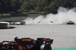 Haas driver Romain Grosjean of France, top left, and Red Bull driver Max Verstappen of the Netherlands go off the track during the Formula One Grand Prix of Tuscany, at the Mugello circuit in Scarperia, Italy, Sunday, Sept. 13, 2020. (AP Photo/Luca Bruno, Pool)