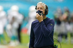 Seattle Seahawks head coach Pete Carroll looks up during the first half of an NFL football game against the Miami Dolphins, Sunday, Oct. 4, 2020, in Miami Gardens, Fla. (AP Photo/Wilfredo Lee)