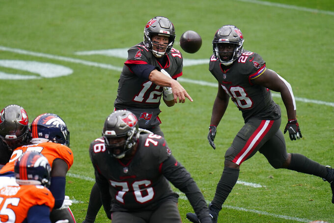 Tampa Bay Buccaneers quarterback Tom Brady throws a pass during the first half of an NFL football game against the Denver Broncos, Sunday, Sept. 27, 2020, in Denver. (AP Photo/Jack Dempsey)