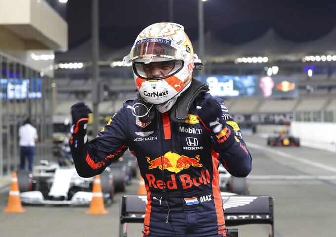 FILE - In this Saturday, Dec. 11, 2020 file photo, Red Bull driver Max Verstappen of the Netherlands reacts after qualifying at the Formula One Abu Dhabi Grand Prix in Abu Dhabi, United Arab Emirates. The season starts Sunday March 28, 2021 with the Bahrain Grand Prix and ends in December 2021 at Abu Dhabi. Red Bull star Max Verstappen won last year's final race in Abu Dhabi in style and looked hugely confident in testing. (AP Photo/Kamran Jebreili, Pool, File)