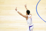 Phoenix Suns' Devin Booker reacts after making a basket during the second half of an NBA basketball game against the Philadelphia 76ers, Wednesday, April 21, 2021, in Philadelphia. (AP Photo/Matt Slocum)