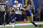 New England Patriots' Rob Gronkowski (87) runs from Los Angeles Rams' Samson Ebukam (50) after catching a pass during the second half of the NFL Super Bowl 53 football game Sunday, Feb. 3, 2019, in Atlanta. (AP Photo/John Bazemore)