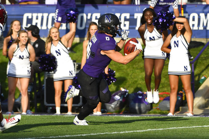 Northwestern running back Drake Anderson (6) scores a touchdown against UNLV during the second half of an NCAA college football game, Saturday, Sept. 14, 2019, in Evanston, Ill. (AP Photo/Matt Marton)