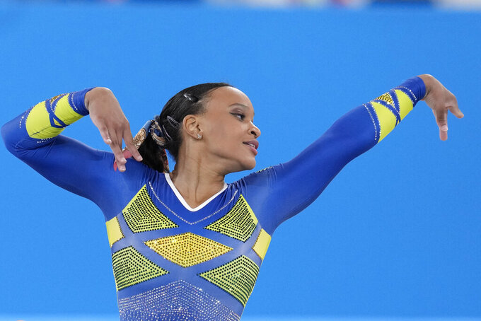 Rebeca Andrade, of Brazil, performs on the floor during the artistic gymnastics women's all-around final at the 2020 Summer Olympics, Thursday, July 29, 2021, in Tokyo. (AP Photo/Natacha Pisarenko)
