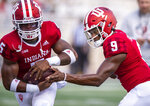 Indiana quarterback Michael Penix Jr. (9) hands off to running back Stephen Carr (5) as the team warms up before an NCAA college football game against Idaho, Saturday, Sept. 11, 2021, in Bloomington, Ind. (AP Photo/Doug McSchooler)