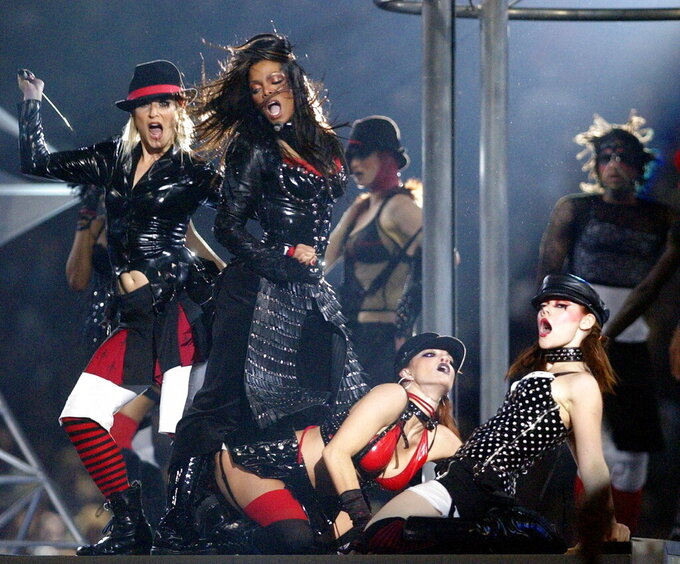 FILE - In this Sunday, Feb. 1, 2004 file photo,J anet Jackson, center, performs at halftime of Super Bowl XXXVIII in Houston. Regardless of your musical tastes, it seems the Super Bowl halftime show has gone there. From the sublime (Tony Bennett) to the ridiculous ( Janet Jackson's ``uncovering''), and from Michael Jackson's moonwalks to U2's majestic remembrance of the 911 victims, the halftime presentations have drawn nearly as much attention as the NFL championship game itself.(AP Photo/Amy Sancetta, File)