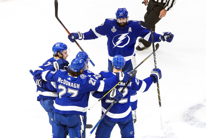 Tampa Bay Lightning' Kevin Shattenkirk (22) celebrates his goal with teammates during first-period NHL Stanley Cup finals hockey action against the Dallas Stars in Edmonton, Alberta, Monday, Sept. 21, 2020. (Jason Franson/The Canadian Press via AP)