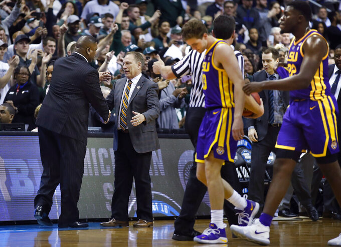 LSU interim coach Tony Benford, left, congratulates Michigan State coach Tom Izzo at the end of an NCAA men's college basketball tournament East Region semifinal in Washington, Friday, March 29, 2019. Michigan State won 80-63. (AP Photo/Alex Brandon)