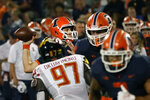 Illinois quarterback Brandon Peters passes into the end zone during the first half of an NCAA college football game against Maryland Friday, Sept. 17, 2021, in Champaign, Ill. (AP Photo/Charles Rex Arbogast)
