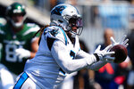 Carolina Panthers outside linebacker Shaq Thompson intercepts a pass against the New York Jets during the first half of an NFL football game Sunday, Sept. 12, 2021, in Charlotte, N.C. (AP Photo/Jacob Kupferman)