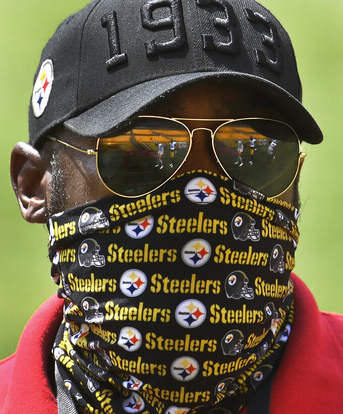 FILE - Pittsburgh Steelers head coach Mike Tomlin watches the defense during an afternoon NFL football practice, Friday, Aug. 21, 2020, at Heinz Field in Pittsburgh. Pittsburgh plays at the New York Giants on Mondasy night, Sept. 14. (Peter Diana/Pittsburgh Post-Gazette via AP, File)