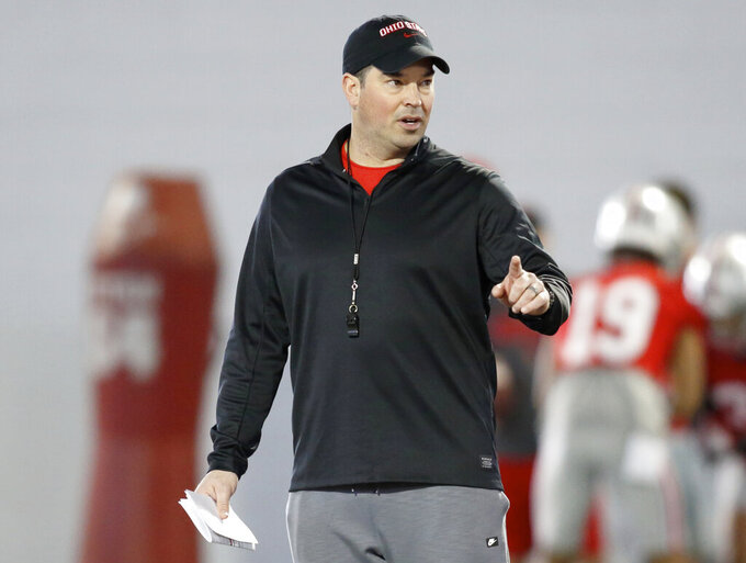 FILE - In this Wednesday, March 6, 2019 file photo, Ohio State NCAA college football head coach Ryan Day gestures during football practice in Columbus, Ohio. New Ohio State coach Ryan Day's 10 assistant coaches will be paid a total of more than $7.4 million this year. Contracts of the assistants were released by Ohio State on Monday, March 11, 2019. Co-defensive coordinator Greg Mattison tops the list at $1.1 million. (AP Photo/Paul Vernon, File)