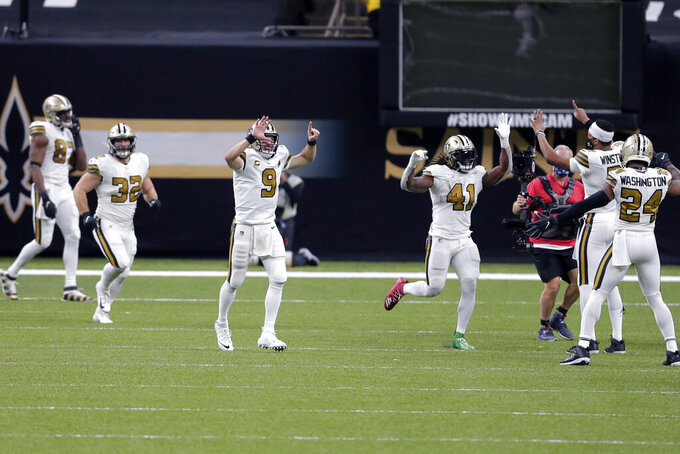 New Orleans Saints running back Alvin Kamara (41) celebrates his sixth touchdown of the game, tying an NFL record, in the second half of an NFL football game against the Minnesota Vikings in New Orleans, Friday, Dec. 25, 2020. The Saints won 52-33.(AP Photo/Brett Duke)