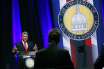 Democratic State Attorney General Jim Hood gestures as he answers a moderator's question during the first televised gubernatorial debate with Republican Lt. Gov. Tate Reeves at the University of Southern Mississippi in Hattiesburg, Miss., Thursday, Oct. 10, 2019. (AP Photo/Rogelio V. Solis, Pool)