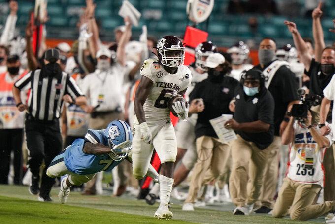 Texas A&M running back Devon Achane (6) runs for a touchdown during the second half of the Orange Bowl NCAA college football game, Saturday, Jan. 2, 2021, in Miami Gardens, Fla. Texas A&M defeated North Carolina 41-27. (AP Photo/Lynne Sladky)