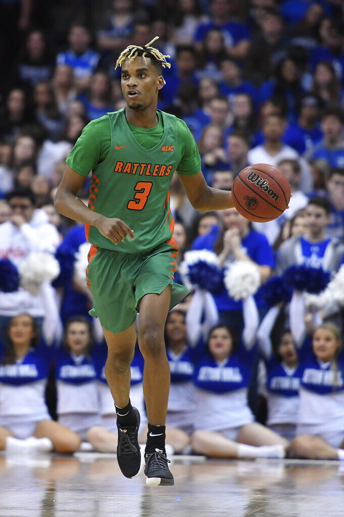 Florida A&M guard MJ Randolph (3) dribbles the ball during the first half of an NCAA college basketball game against Seton Hall, Saturday, Nov. 23, 2019 in Newark, N.J. (AP Photo/Sarah Stier)