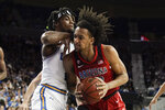 Arizona forward Zeke Nnaji, right, drives to the basket around UCLA forward Jalen Hill during the first half of an NCAA college basketball game in Los Angeles, Saturday, Feb. 29, 2020. (AP Photo/Chris Carlson)
