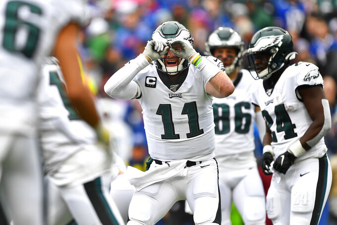 Philadelphia Eagles quarterback Carson Wentz (11) gestures during the first half of an NFL football game against the Buffalo Bills, Sunday, Oct. 27, 2019, in Orchard Park, N.Y. (AP Photo/Adrian Kraus)