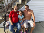 In this Wednesday, Sept. 12, 2018, Mercedes O'Neill, her 6-year-old daughter Sophieand boyfriend Kelly Johnson sit outside their home in North Myrtle Beach, S.C. O'Neill thought a long time about evacuating from Hurricane Florence but decided they couldn't afford it. (AP Photo/Jeffrey Collins)