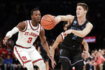 Villanova's Collin Gillespie (2) passes away from St. John's Rasheem Dunn (3) during the second half of an NCAA college basketball game Tuesday, Jan. 28, 2020, in New York. Villanova won 79-59. (AP Photo/Frank Franklin II)