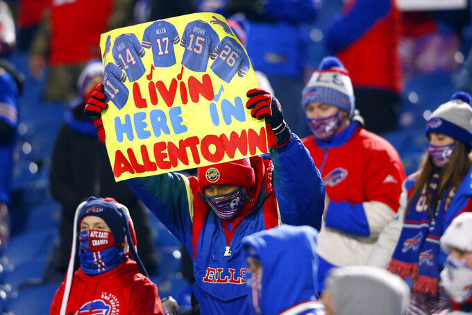 Buffalo Bills fans cheer during the first half of an NFL divisional round football game against the Baltimore Ravens Saturday, Jan. 16, 2021, in Orchard Park, N.Y. (AP Photo/Jeffrey T. Barnes)
