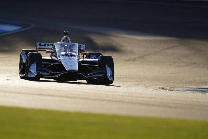 Josef Newgarden drives during qualifying for the IndyCar auto race at Indianapolis Motor Speedway, Thursday, Oct. 1, 2020, in Indianapolis. (AP Photo/Darron Cummings)