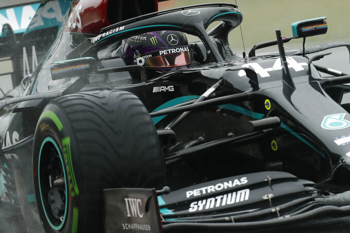 Mercedes driver Lewis Hamilton of Britain steers his car during the second practice session for the Hungarian Formula One Grand Prix at the Hungaroring racetrack in Mogyorod, Hungary, Friday, July 17, 2020. The Hungarian F1 Grand Prix will be held on Sunday. (Darko Bandic/Pool via AP)