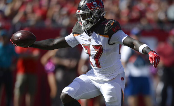 Tampa Bay Buccaneers running back Ronald Jones II (27) scores on a 7-yard touchdown run against the Arizona Cardinals during the first half of an NFL football game Sunday, Nov. 10, 2019, in Tampa, Fla. (AP Photo/Jason Behnken)