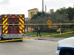 Police tape surrounds an area outside the Victory City Church in Riviera Beach, Fla., on Saturday, Feb. 1, 2020. Police say a fatal shooting happened after a funeral service at the church. (Hannah Morse/The Palm Beach Post via AP)