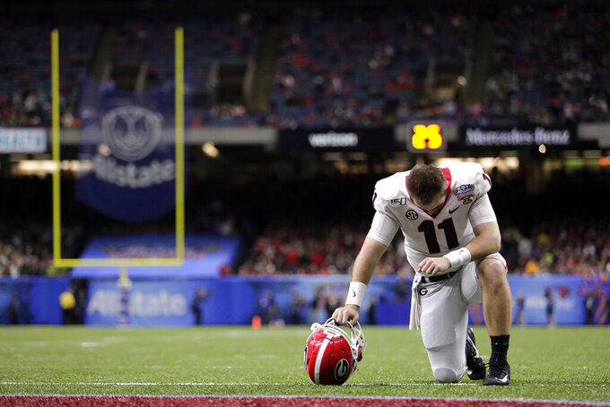 Georgia quarterback Jake Fromm (11) kneels down on the field before the Sugar Bowl NCAA college football game against Baylor in New Orleans, Wednesday, Jan. 1, 2020. (AP Photo/Brett Duke)